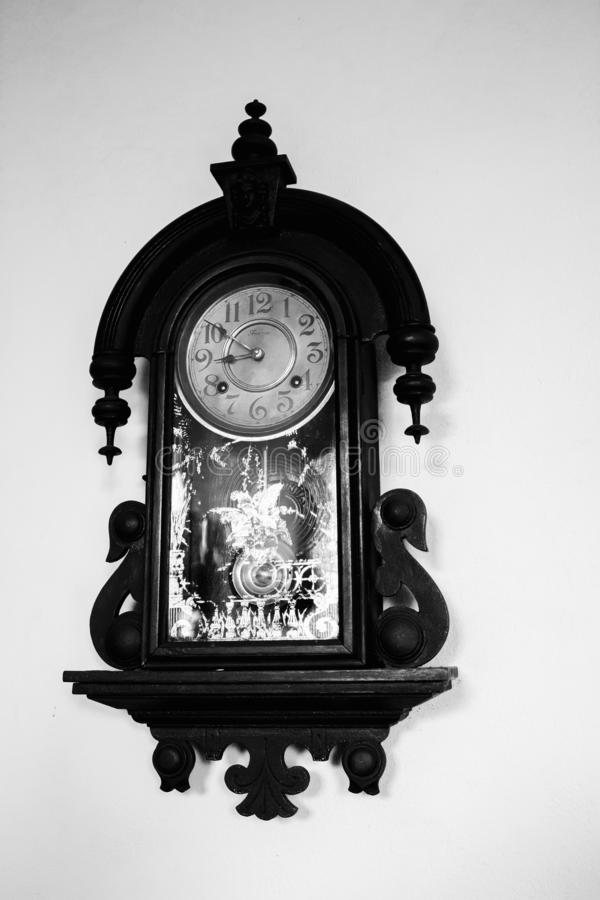 Old clock. A beautiful antique wall clock.  The watch is used as a gauge of time since antiquity stock photo