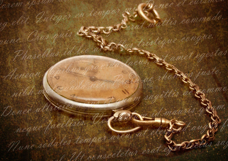 Old clock with chain lying on rough green surface royalty free stock photography