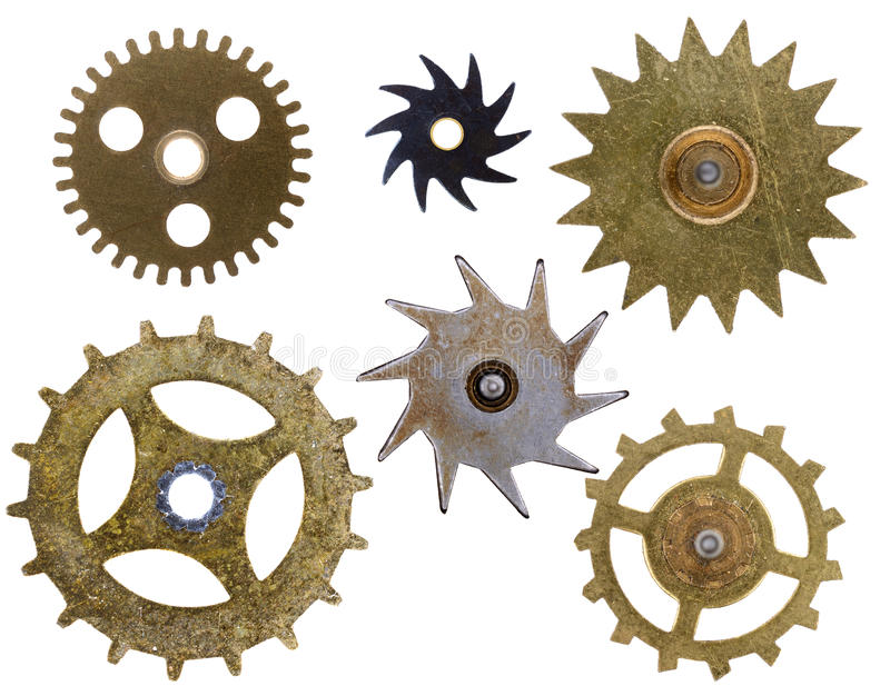 Old Clock Cogs Isolated. Various shaped old clock cogs isolated on a white background stock images