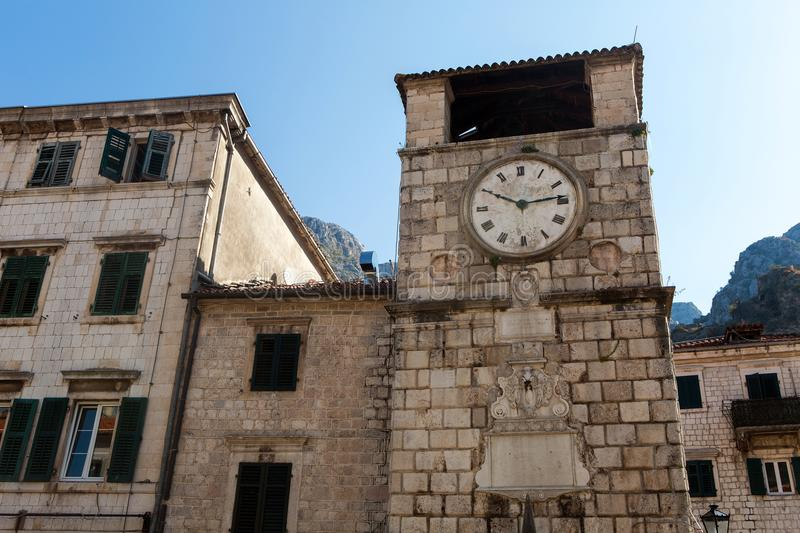 Old clock on the highest stone tower in Montenegro royalty free stock image