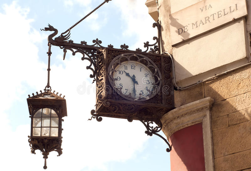 Old clock with lantern stock photography