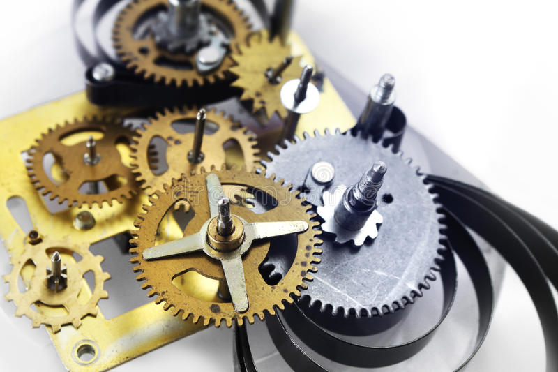 Old clock mechanism. Old clockwork mechanism with brass metal gears and cogs stock images
