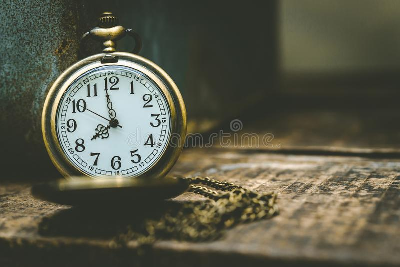 The old clock necklace on wooden stock photo