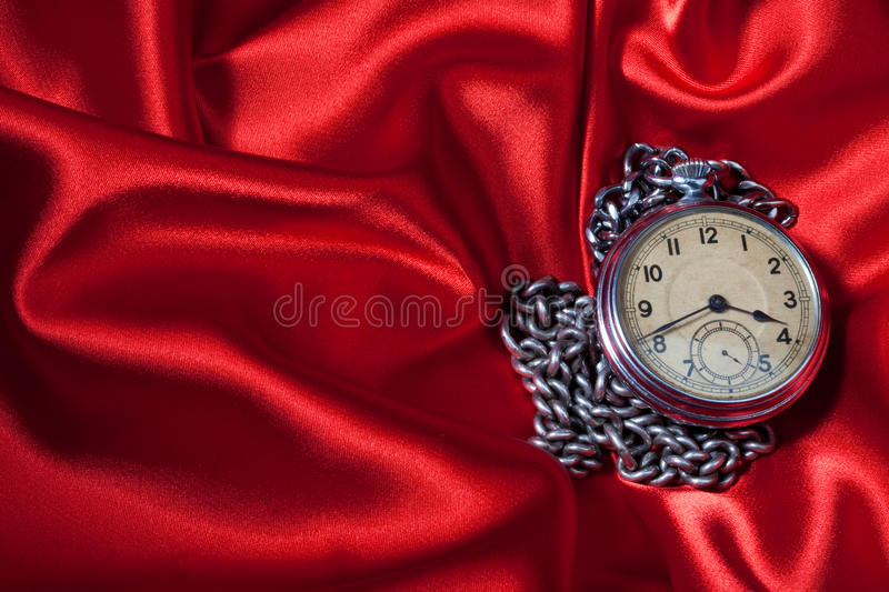 Old clock on red background