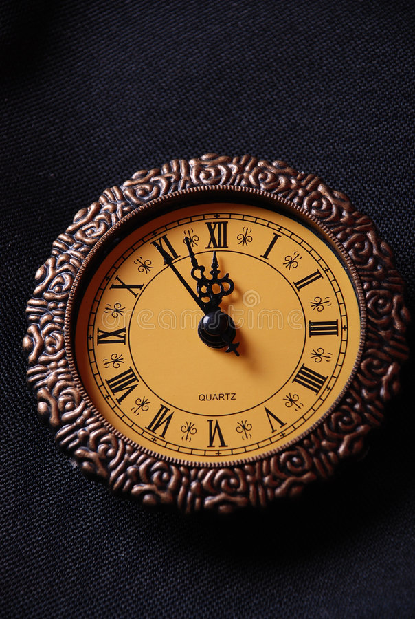 Old clock showing time about twelve. High resolution image stock images