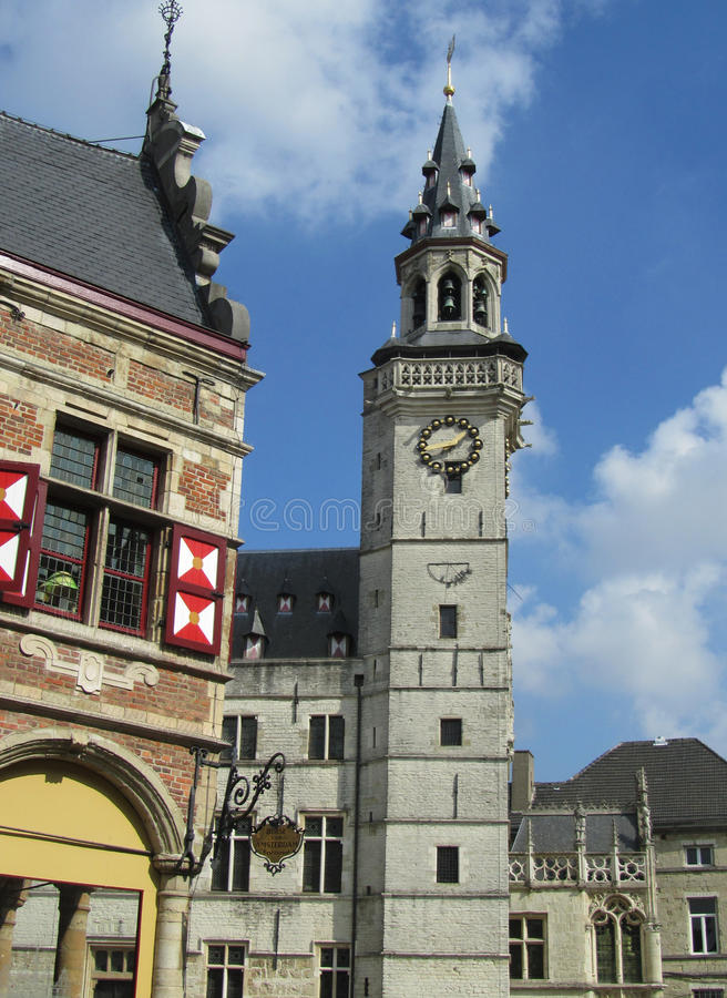 Old Clock Tower, Aalst, Belgium. AALST, BELGIUM, SEPTEMBER 16 2014: The Grote Markt in Aalst, with the old Belfort and surrounding buildings. Aalst is a large royalty free stock photo