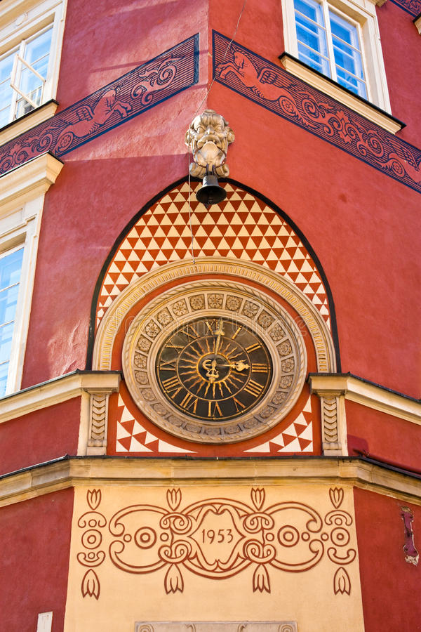 Old clock on the wall in the old town of Warsaw royalty free stock photos