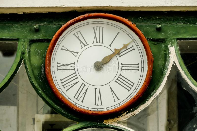 old clock on the wall, in Sweden Scandinavia North Europe royalty free stock images