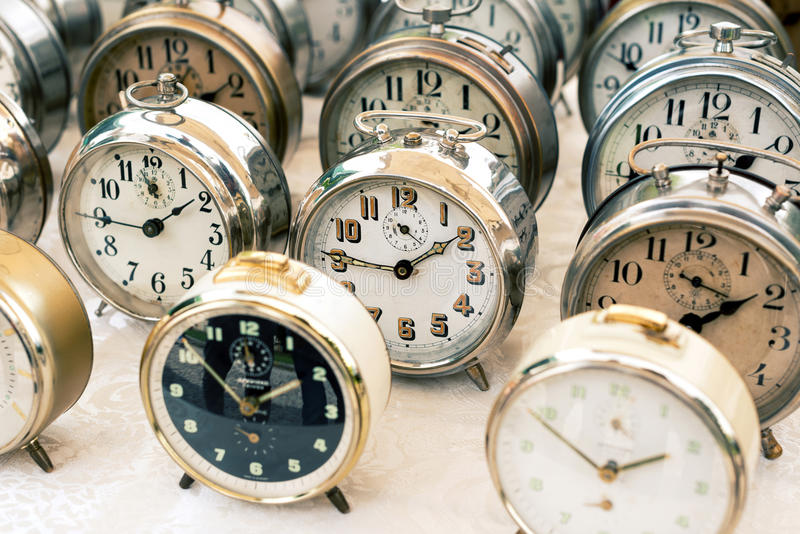 Old clocks at the flea market stock photos
