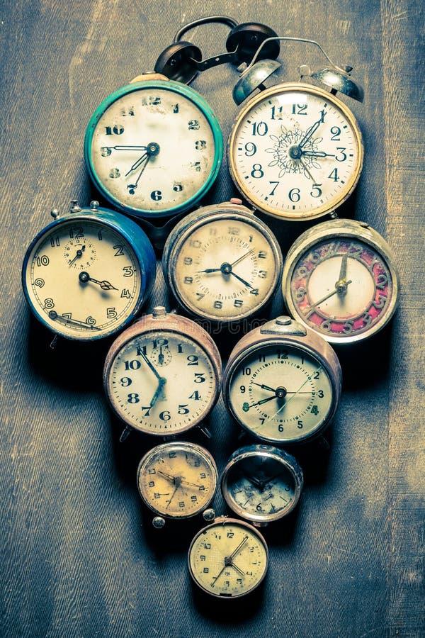 Old clocks in pile. Closeup of old clocks in pile stock image