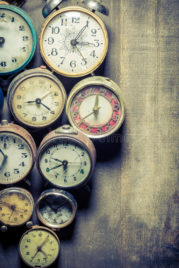 Old clocks in pile. Closeup of old clocks in pile royalty free stock photography