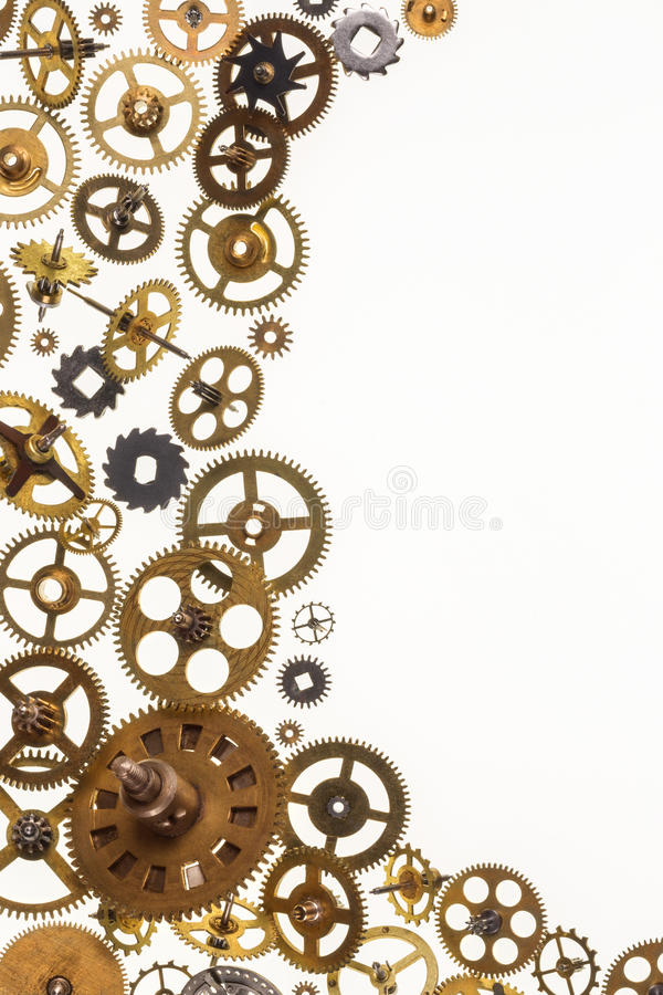 Old clockwork cogs and clock parts - Space for Text. Selection of old brass clockwork clock parts with space for text stock photography