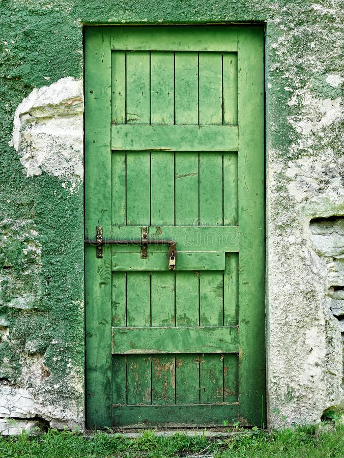 Old closed green door. Old or ruined closed green door royalty free stock images