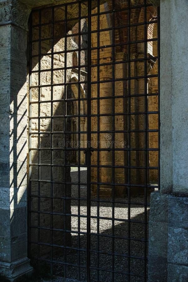 Old closed iron bars door stock photo