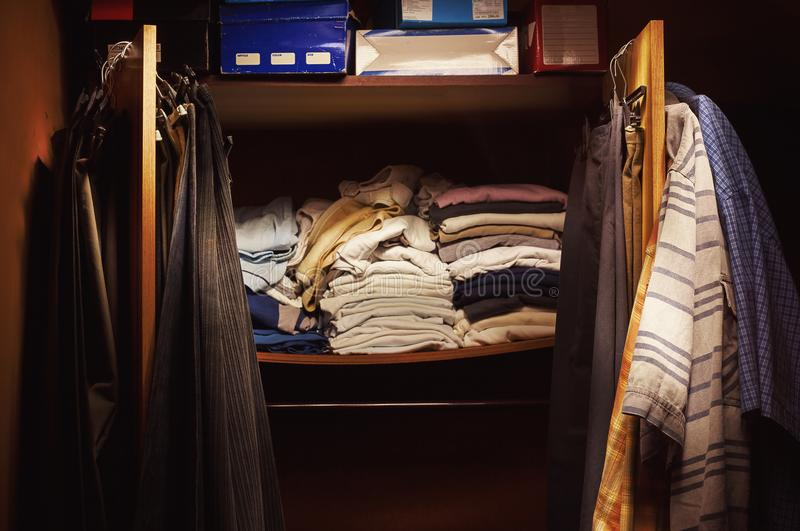 Old Clothes on Closet. A lot of old and clean clothes on and in the closet royalty free stock photo