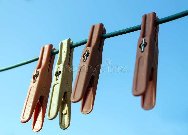 Old clothespins on a wire for drying clothes royalty free stock images