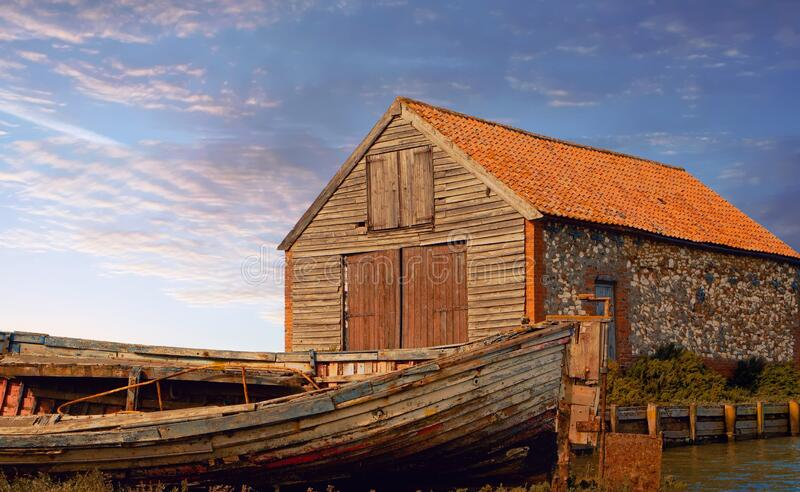 Old coal barn and wreck, Thornham. stock photography