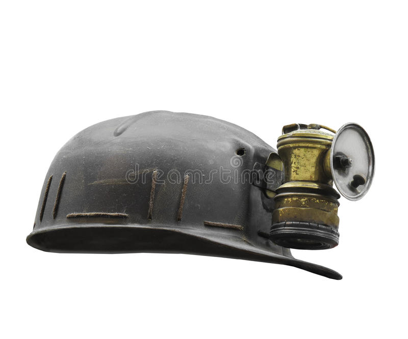 Old coal miner's hat isolated. Old coal miner's hat or helmet with a carbide lamp. Isolated on white royalty free stock photo