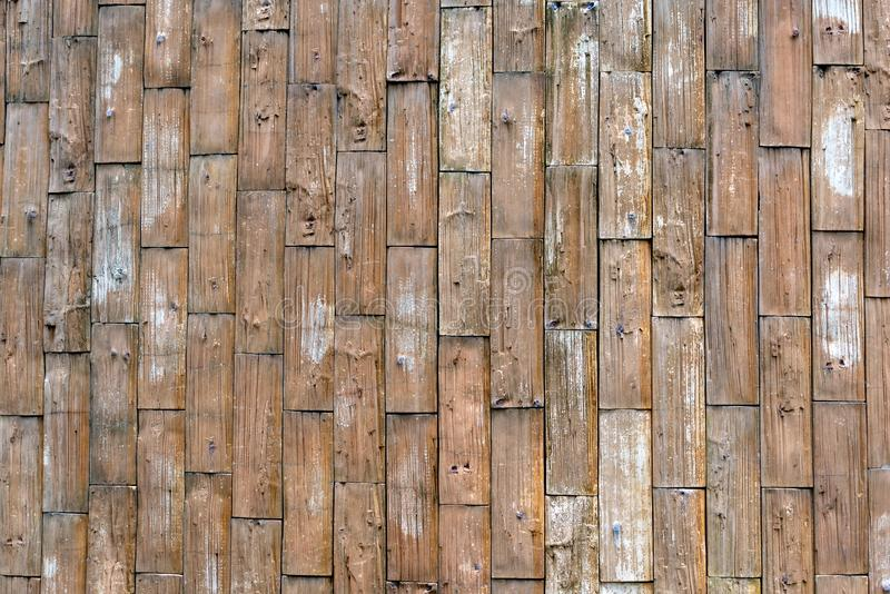 a old rough wood plank wall as a texture pattern background with copy space. yellow,grunge. royalty free stock images