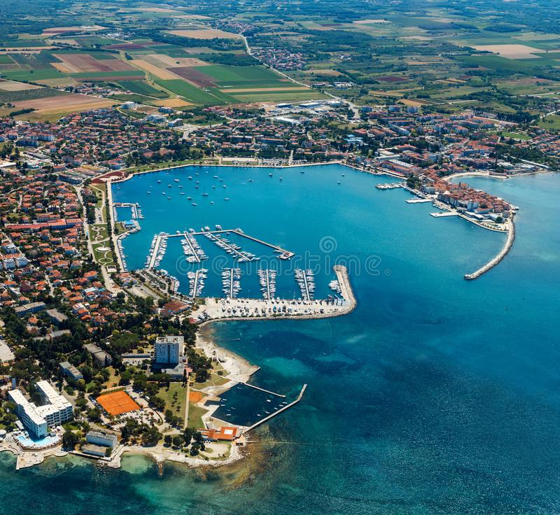 Old coastal city Umag in Croatia, aerial view. Istria, Europe royalty free stock image