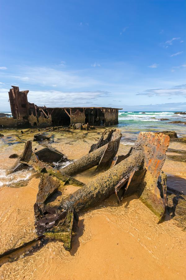 Old coastline shipwreck with rusted steelwork royalty free stock images