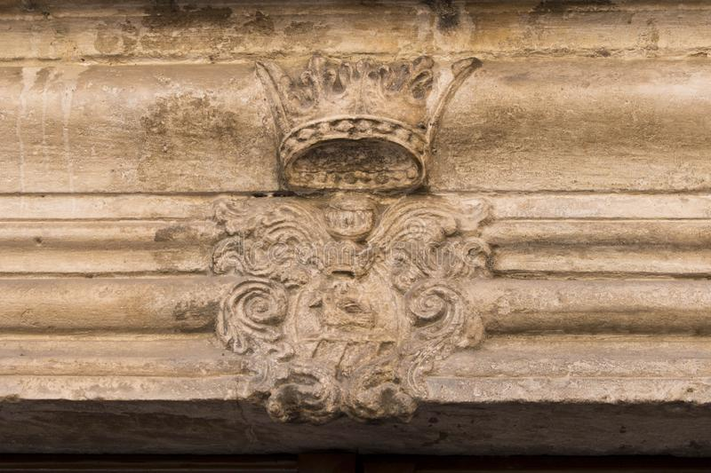 Old coat of arms on the facade of the house . The lamp is old town. Montenegro.  royalty free stock photography