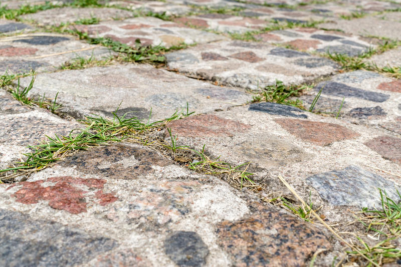 Old cobbled pavement royalty free stock photography