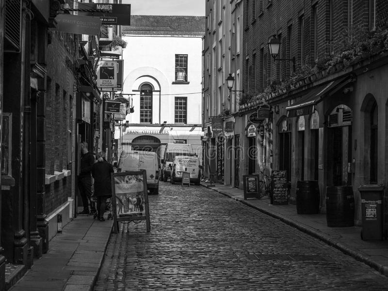 Old cobbled street in Temple Bar, Dublin, Ireland, Irish pubs and wooden barrels. Old cobbled street in Temple Bar, Dublin, Ireland with Irish pubs and wooden royalty free stock images