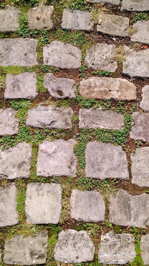 Old cobblestone footpath stock photography