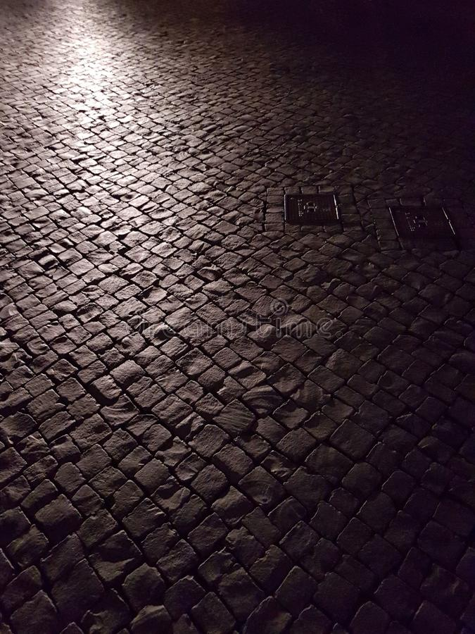 Old cobblestone and light in the evening. Alley stock photography