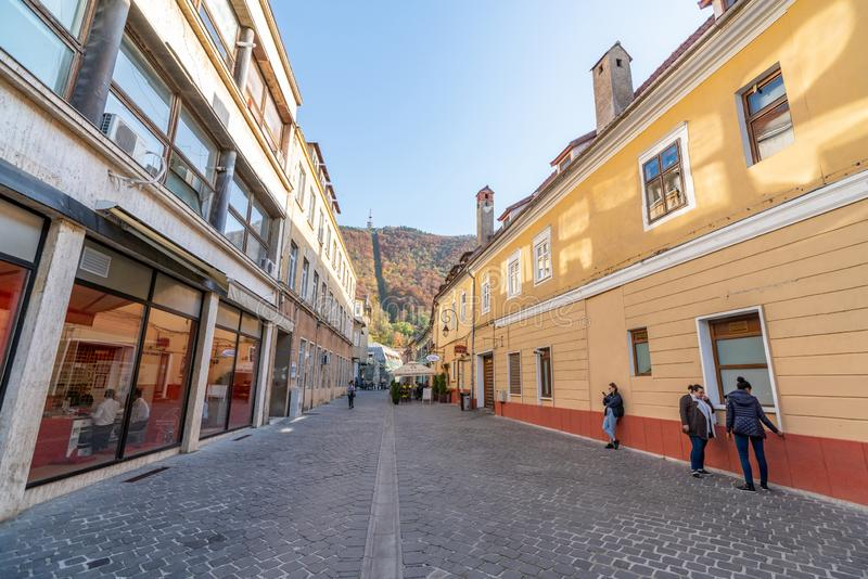 Old cobblestone pavement in the historic part of Brasov in Romania. One of the ten largest cities in Romania. Located in the heart of Romania, the city of Brasov royalty free stock photo