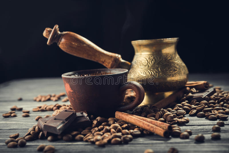 Old coffee cup and turk with roasted beans stock photos