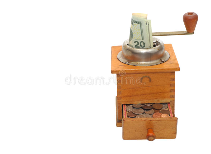 Old coffee grinder with a bank note and coins