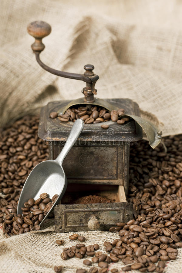 Download Old Coffee Grinder With Coffee Beans Royalty Free Stock Photos - Image: 13107528