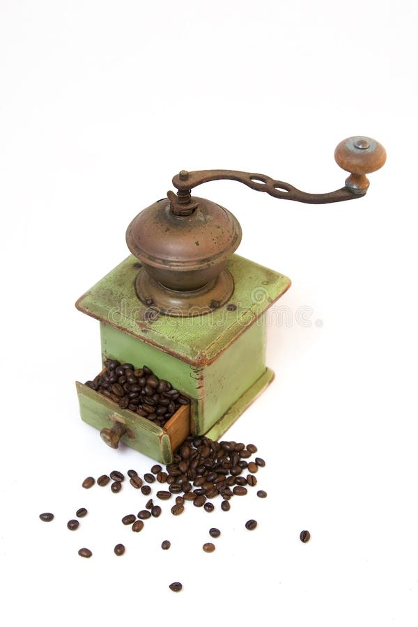 Old coffee grinder with coffee beans royalty free stock images