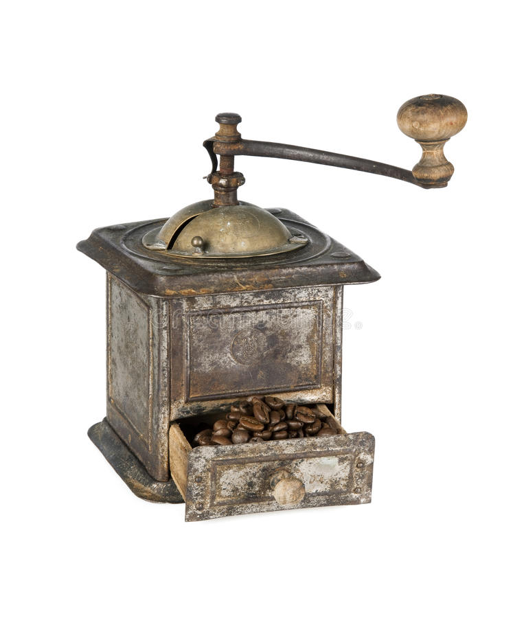 Old coffee grinder with coffee beans isolated stock image