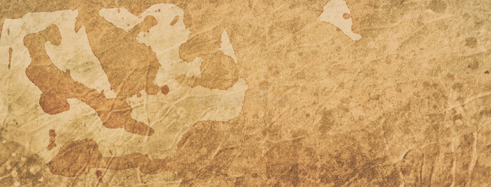 Old coffee or tea stained paper background illustration with texture and grunge, vintage or ancient parchment royalty free stock photography