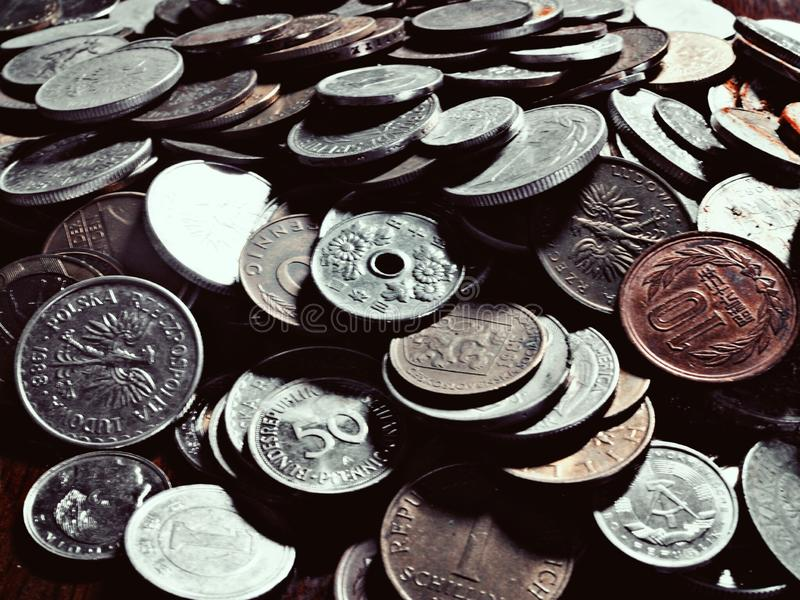 Old Coins From Around the World. Value of time and money stock photography