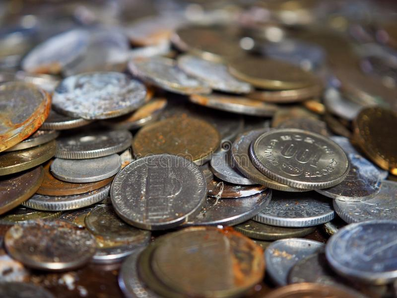 Old Coins From Around the World. Value of time and money stock photos