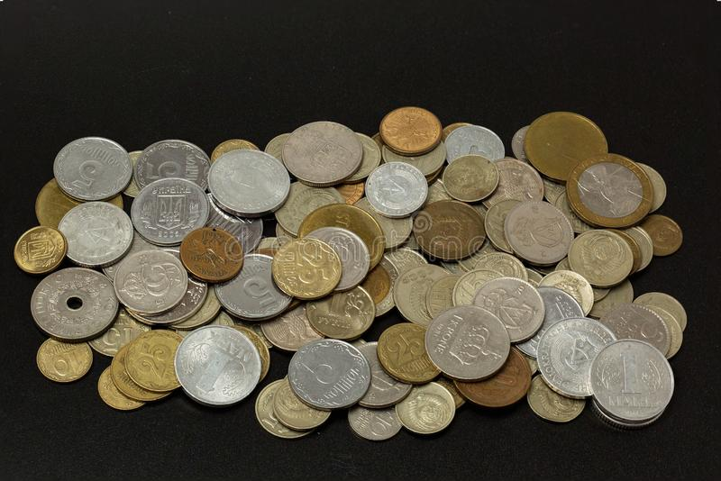 Old coins on black background. Old currency of different countries. Antic. Currency background. Coins background. stock image