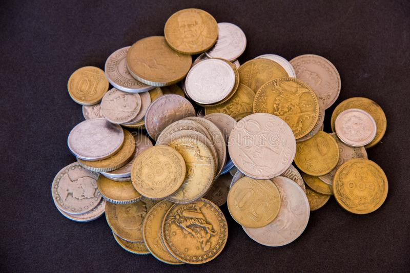 Old coins reunited. In black background royalty free stock photo
