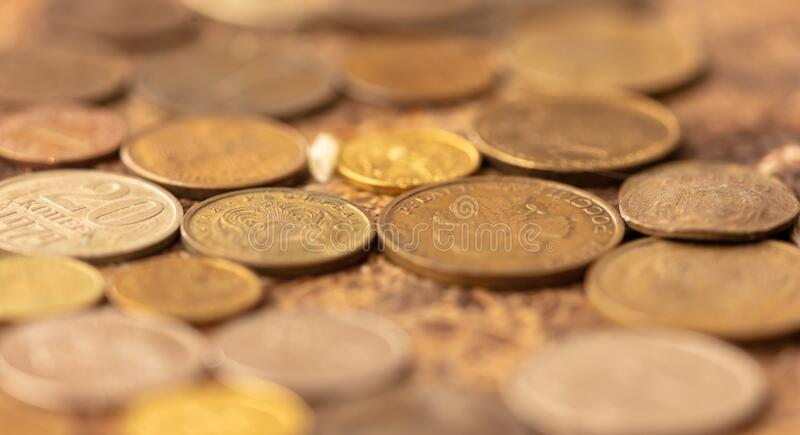 Old coins on the table as background. Old coins on the table as background royalty free stock image