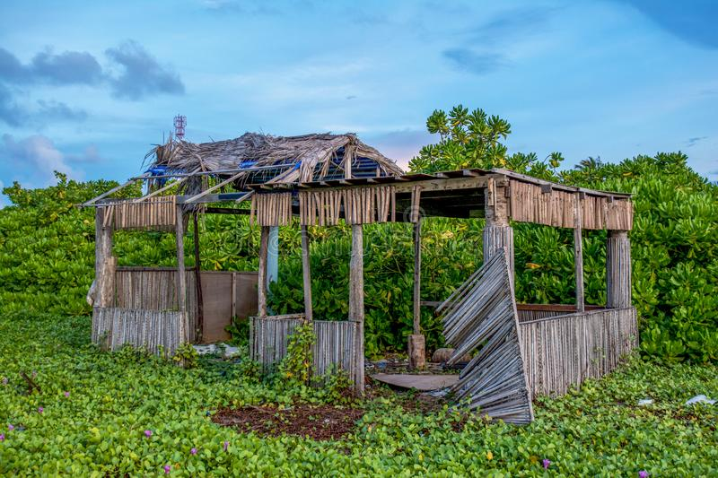 Old collapsed wooden house at the tropical island stock photography
