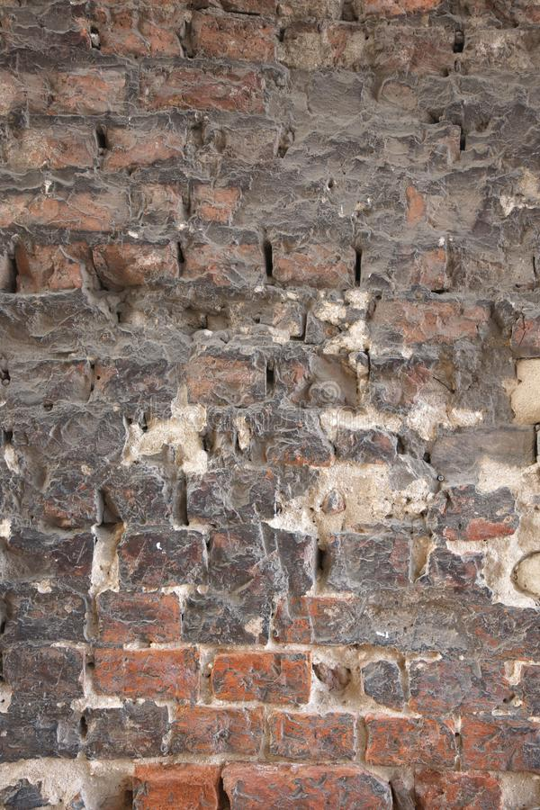 The old collapsing brick wall stock image