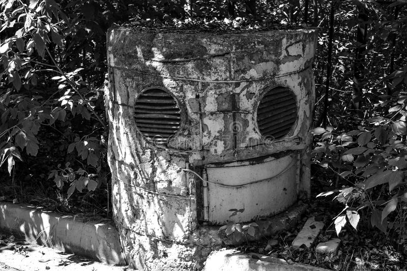 Old collapsing ventilation shaft from the anti-nuclear shelter. The Soviet period. stock image