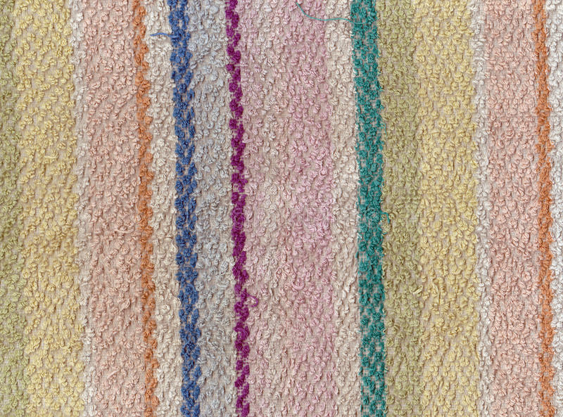 Old color bath towel texture with stripes. royalty free stock images