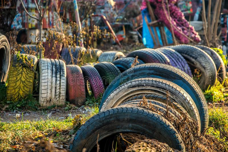 Old colored painted tires in Metelkova city, Ljubljana royalty free stock image