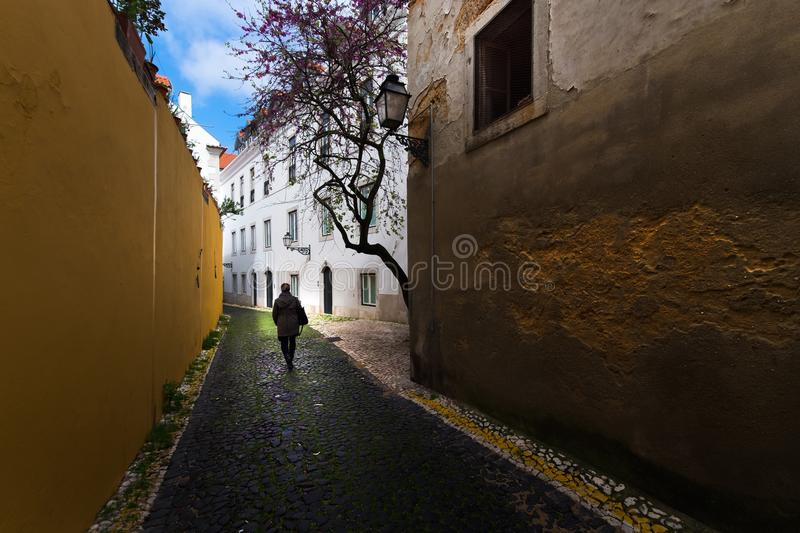 Old colored streets and the ordinary life of the city of Lisbon. Portugal. Map of the old city royalty free stock photos