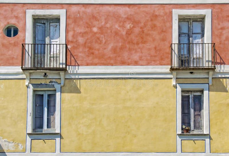 Old colorful building facade. A typical colorful building facade in southern italy, Acciaroli, Cilento coast royalty free stock image