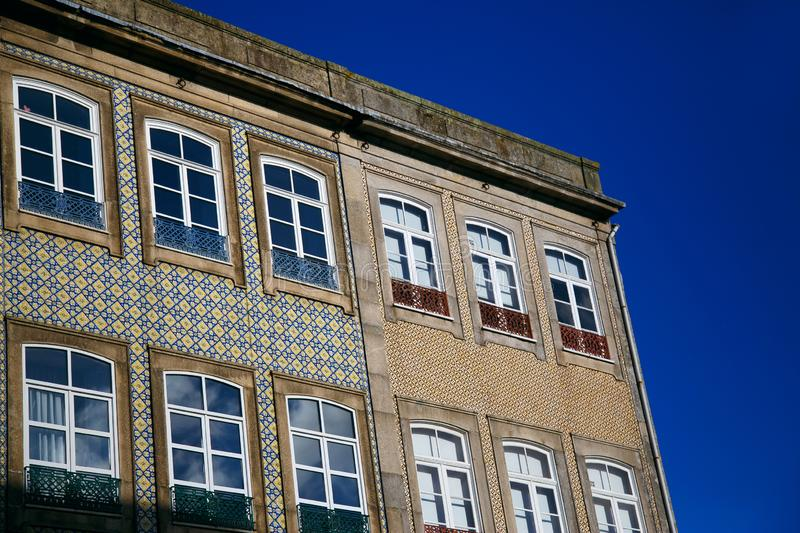 Old colorful building and facades against the blue sky in the historic center of Porto, Portugal.  royalty free stock photo